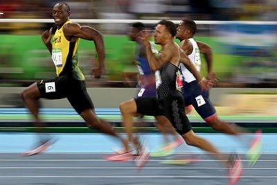Ямайский бегун Болт улыбнулся в камеру во время стометровки и стал мемом